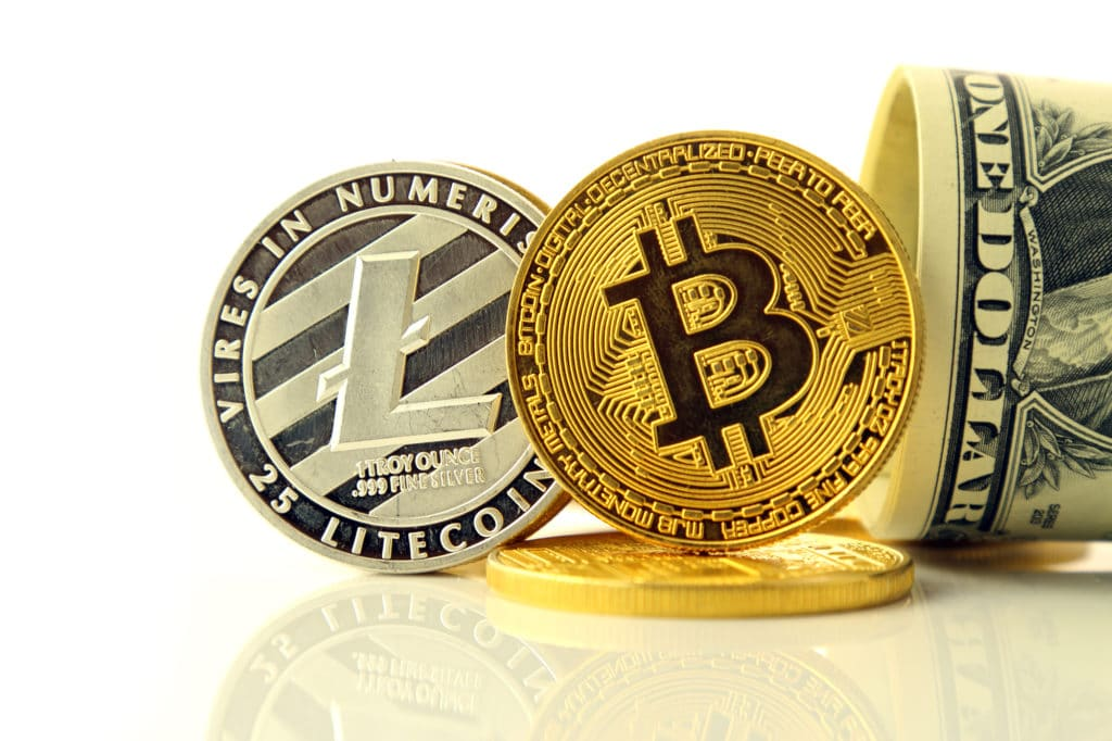 Litecoin, Bitcoin and a dollar bill